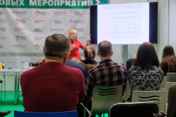 Moscow, Russia - March, 2, 2019: image of people sitting at a conference