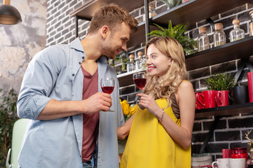 Couple having amazing romantic evening at home drinking red wine