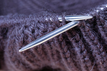 image of Close-up image of knitting on metal knitting needles.