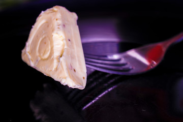 image of melted cheese on a fork