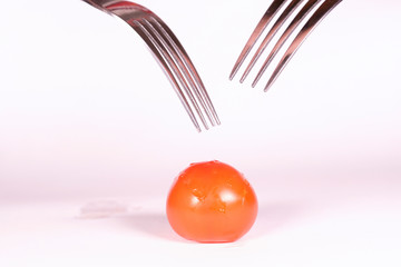 image of a tomato pinned on 2 forks