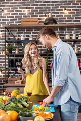 Husband feeling joyful cooking dinner and spending time with his woman