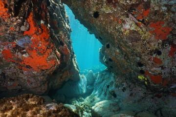 A passage below rocks underwater in the Mediterranean sea, natural scene, Italy