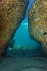 A passage below rocks underwater in the Mediterranean sea, natural scene, France