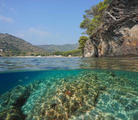 Spain rocky coast near Cala Montjoi, split view half over and under water, Mediterranean sea, Costa Brava, Catalonia
