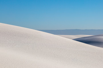Gypsum Sand Dunes at White Sands National Monument, with a blue sky overhead