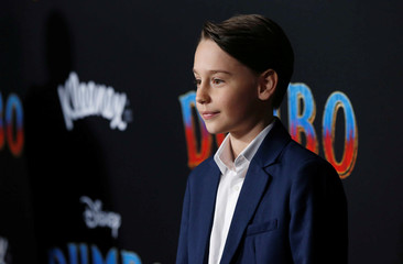 """Cast member Finley Hobbins poses at the premiere for the movie """"Dumbo"""" in Los Angeles"""