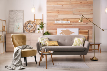Stylish living room interior with comfortable sofa. Idea for home decor Fototapete