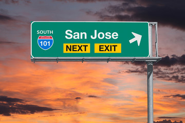 San Jose California next exit route 101 freeway sign with sunset sky.