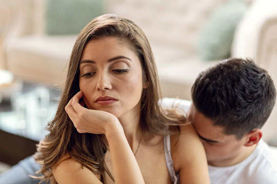 Young dissatisfied woman ignoring her boyfriend.
