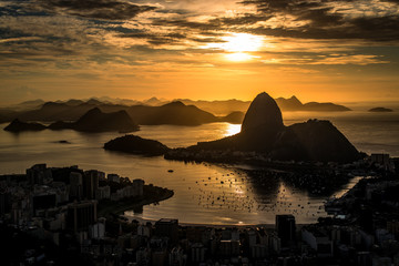 Wall Mural - Golden Sunrise over Guanabara Bay in Rio de Janeiro with Sugarloaf Mountain in the Horizon