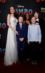 "Angelina Jolie pose with her children at the premiere for the movie ""Dumbo"" in Los Angeles"