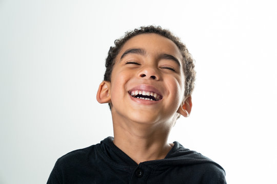 portrait of a laughing boy isolated on white