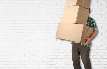 Moving. lots of cardboard boxes and man on background