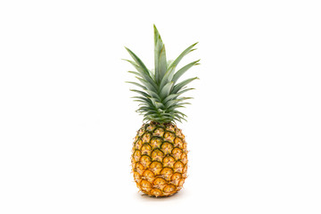 Pineapple with green leaves isolated on white background.