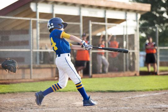 Youth baseball batter swinging