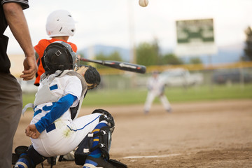 Youth baseball game in action