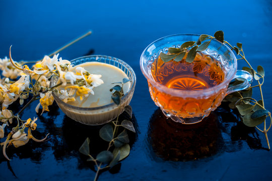 Saragava or drumstick or Moringa oleifera flower on wooden surface along with its paste and herbal extracted tea.
