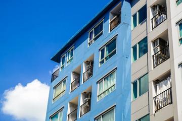 Modern condominium flat 8 floor building with blue sky cloud Wall mural
