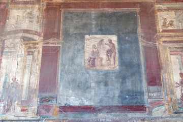The city of Pompeii buried under a layer of ash by the volcano Mount Vesuvius. Murals on the walls