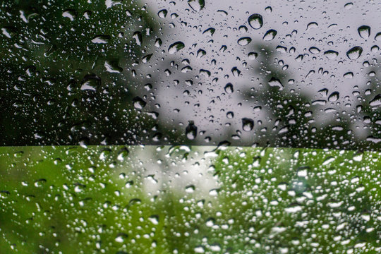 rain drops on window with tint