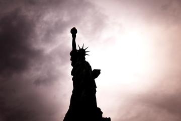 November 2018 - Backlight view of American symbol Statue of Liberty silhouette in New York, USA.