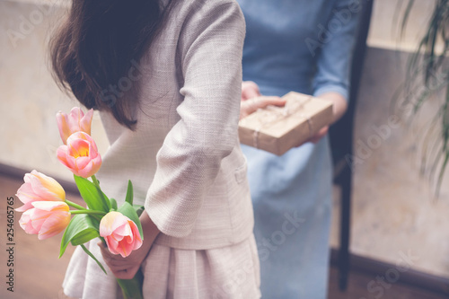 Happy Mother's Day concept. Little girl congratulates mom. Toning. Selective focus
