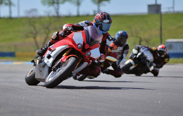 Road racing motorcykel in high speed into a curve, panning shot Wall mural