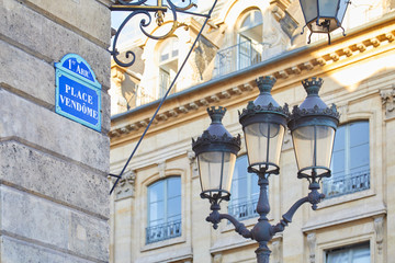 PARIS, FRANCE - JULY 21, 2017: Famous Place Vendome corner with street sign and lamp in Paris, France. Fotomurales