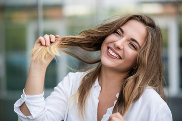 Portrait of teen girl playing with her hair