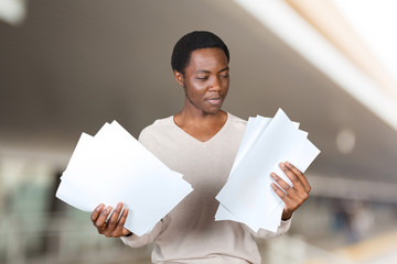 Young African American man reading documents