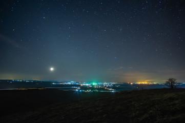 Night village on a background of stars
