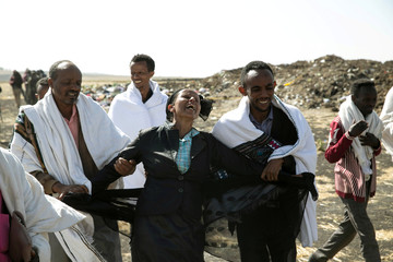 Kebebew Legesse, the mother of Ethiopian Airlines cabin crew Ayantu Girmay mourns at the scene of the Ethiopian Airlines Flight ET 302 plane crash, near the town Bishoftu