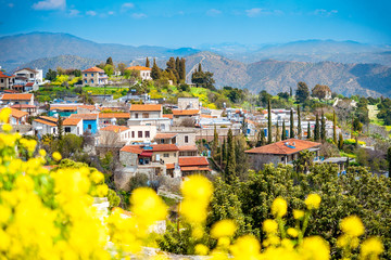 Amazing view of famous landmark tourist destination valley Pano Lefkara village, Larnaca, Cyprus known by ceramic tiled house roofs and Greek orthodox church