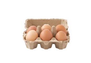 Fresh brown eggs in carton on isolated