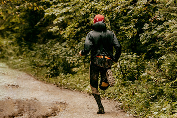 Fototapete - back runner man running on spring path forest