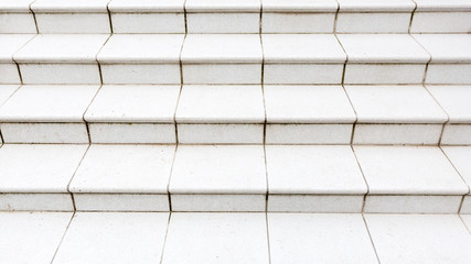 Marble stone granite white stairs. Textured background. Close up image.