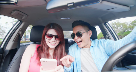 couple take selfie in car