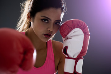 woman posing in boxing gloves