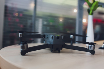 New dark grey drone quadcopter with digital camera and sensors.
