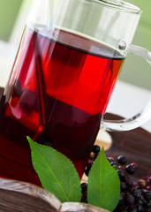 Elderberry tea and  in a glass cup