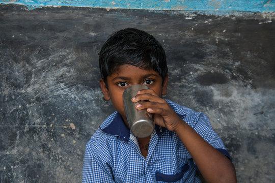 Indian School Children drinking water