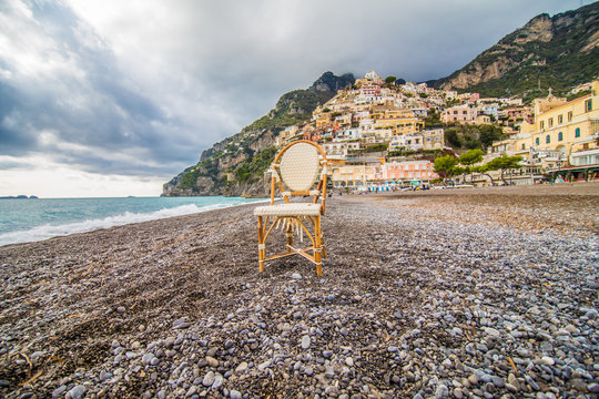 Panoramic view of the beach with colorful buildings of Positano, Italy.
