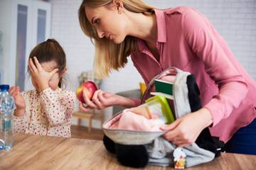 Displeased preparing her daughter for school