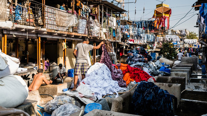 In Dhobi Ghat, Mumbai's famous laundry slum district, clothes and fabrics of all kinds from all over Mumbai is brought to be cleaned.