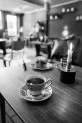 Coffee in a vintage cafe in black and white