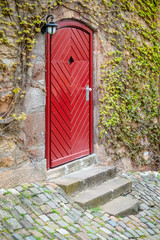 old vintage red wooden door Marburg Germany