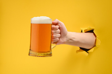 Hand holding a beer glass