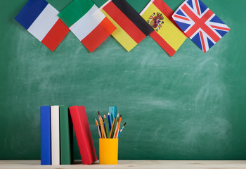 backpack, flags of Spain, France, Great Britain and other countries, books and school supplies of...