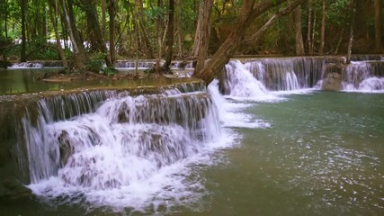 Wall Mural - Waterfall flow standing with forest enviroment view in thailand called Huay or Huai mae khamin in Kanchanaburi Provience, Thailand., Lockdown.